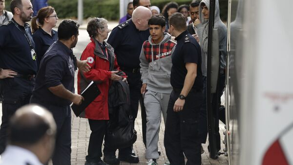 Two unidentified young migrants get off a bus as they arrive at Lunar House, which houses the headquarters of UK Visas and Immigration, in Croydon, south London, Monday, Oct. 17, 2016 - Sputnik International