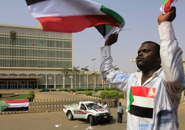 A Sudanese man waves his national flag in Khartoum on July 9, 2011 hours before South Sudan officially declares independence from the north