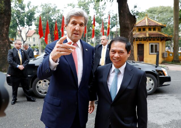 Secretary of State John Kerry, left, arrives with Acting Foreign Minister Bui Thanh Son, at the Ministry of Foreign Affairs, before their meeting Friday, Jan. 13, 2017 in Hanoi, Vietnam