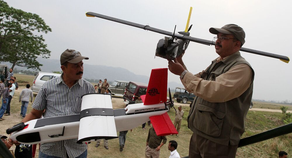 Indian forestry officials hold up unmanned aerial vehicles (UAV) during a demonstration to the media at the Kaziranga National Park, some 250 kilometers east of Guwahati (File)