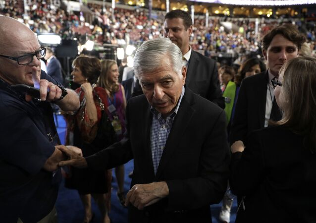 Former Massachusetts Gov. Michael Dukakis arrives on the convention floor during the third day session of the Democratic National Convention in Philadelphia, Wednesday, July 27, 2016