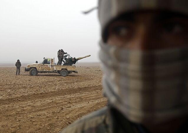 Fighters from the Kurdish-Arab alliance, known as the Syrian Democratic Forces, are seen near the village of Khirbet al-Jahshe, some 35 kilometres from al-Tabaqah on the western outskirts of Raqa as they advance towards the Islamic State (IS) group bastion on December 13, 2016