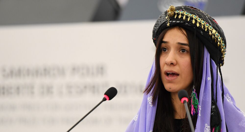 Nadia Murad , public advocates for the Yazidi community in Iraq and survivors of sexual enslavement by the Islamic State jihadists delivers a speech after being awarded co-laureate of the 2016 Sakharov human rights prize, on December 13, 2016 at the European parliament in Strasbourg