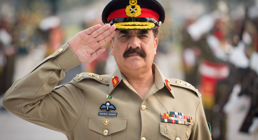 The supreme commander of the Pakistani army General Raheel Sharif salutes as he inspects a military honor guard at the Pakistani army's headquarters in Islamabad on December 9, 2015.