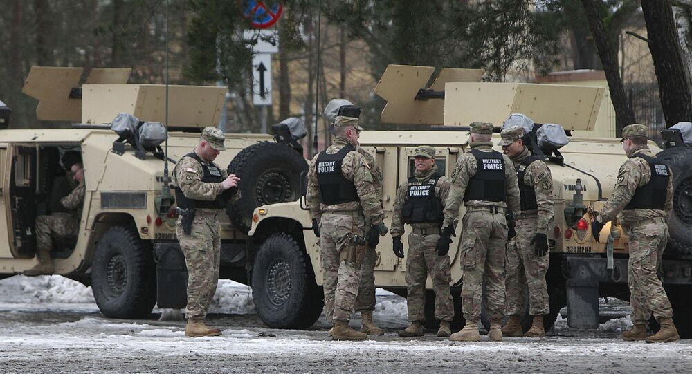 American soldiers attend a official welcome ceremony for the US troops in Zagan, Poland, Thursday, Jan. 12, 2017