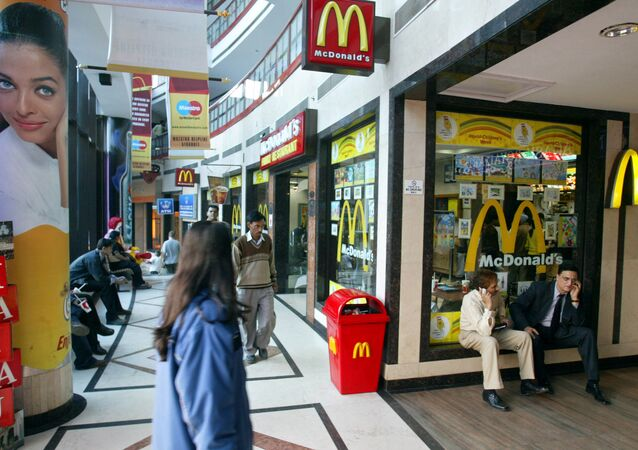 People sit near a McDonalds at a mall in New Delhi, India (File)