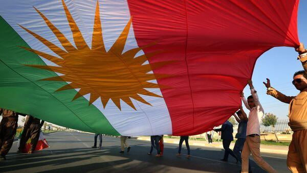 Iraqi Kurdish demonstrators wave a large Kurdish flag (File) - Sputnik International