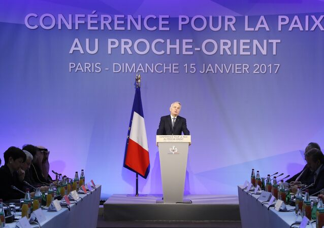 French Minister of Foreign Affairs Jean-Marc Ayrault addresses delegates at the opening of the Mideast peace conference in Paris on January 15, 2017.