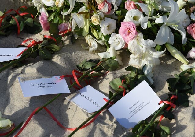 Flowers lie on the beach on June 26, 2016, during a ceremony attended by British and Tunisian officials in memory of those killed a year ago by a jihadist gunman in front of the Riu Imperial Marhaba Hotel in Port el Kantaoui, on the outskirts of Sousse south of the capital Tunis. Tourists fled in horror on June 26, 2015 as a Tunisian gunman pulled a Kalashnikov rifle from inside a furled beach umbrella and went on a shooting spree outside the five-star hotel. 30 Britons were among 38 foreign holidaymakers killed in the attack.