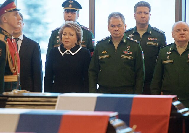 Center, from left: Valentina Matviyenko, chairman of the Russian Federation Council, and Army General Sergei Shoigu, Russian defense minister, during the farewell ceremony for the victims of the Tu-154 crash over the Black Sea, at the Federal Military Memorial Cemetery in the Moscow region.