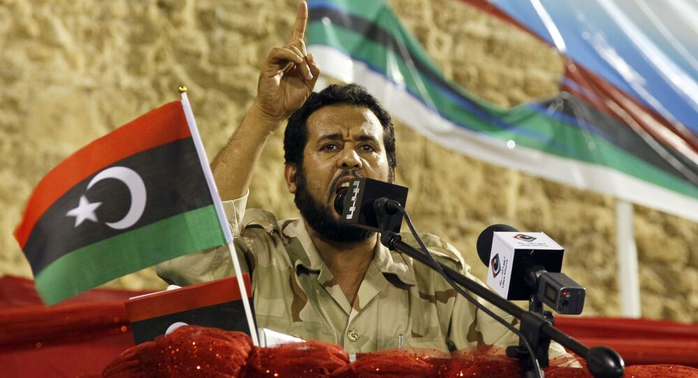 Libya former rebels' Tripoli military commander Abdel Hakim Belhaj delivers his speech during a gathering against ousted Moammar Gadhafi on the Green Square renamed Martyrs Square in Tripoli, Libya, Friday, Sept. 9, 2011.