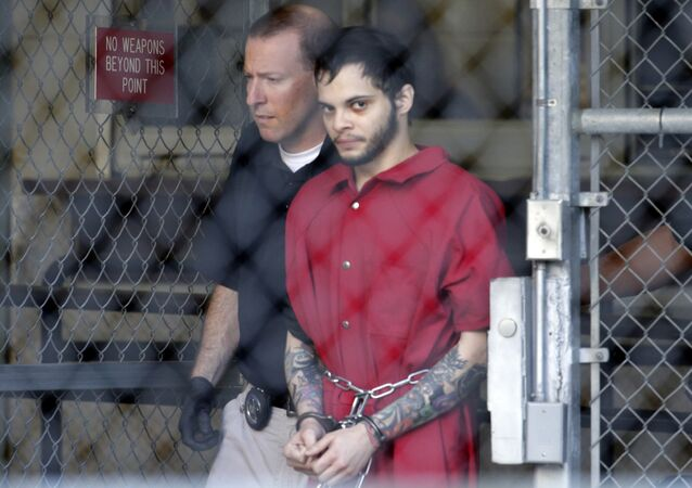 Esteban Santiago, right, leaves the Broward County jail for a hearing in federal court in Fort Lauderdale, Fla