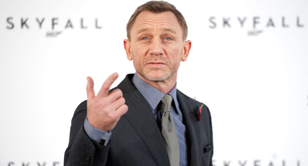 British actor Daniel Craig gestures as he poses for photographers at a photocall to announce the start of production of the 23rd film in the James Bond series; 'Skyfall', in central London on November 3, 2011.