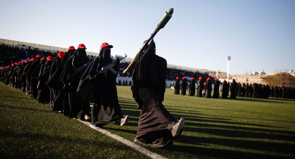 Women loyal to the Houthi movement parade to show support to the movement in Sanaa, Yemen