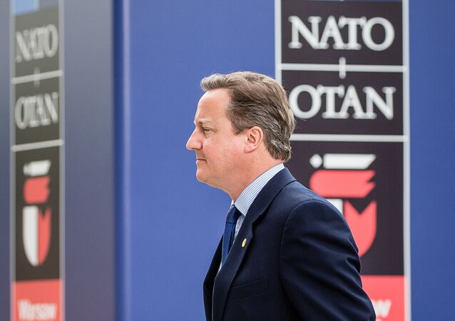 Then Prime Minister of Great Britain David Cameron arrives at the Warsaw Stadium entrance for the second day of NATO summit in Warsaw, Poland on July 9, 2016.