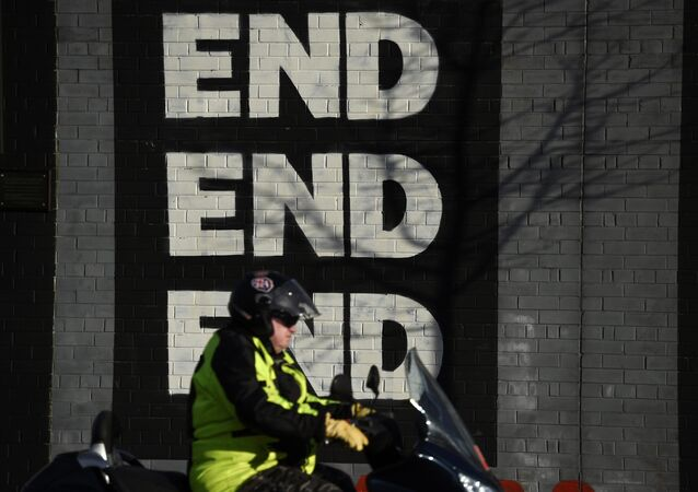 A motorbike is driven past a mural on the Falls Road a day after Northern Ireland's Deputy First Minister Martin McGuinness resigned, throwing the devolved joint administration into crisis, in Belfast Northern Ireland, January 10, 2017.