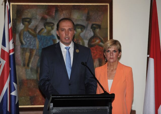 Australian Immigration Minister Peter Dutton (L)