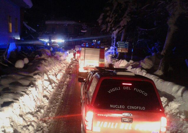Firefighters vehicles make their way to the hotel hit by an avalanche in Farindola, Italy, early Thursday, Jan. 19, 2017