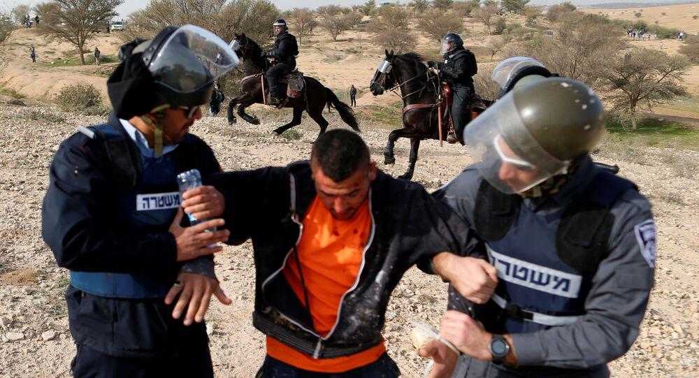 Arab Israelis clash with Israeli riot policemen in Umm Al-Hiran, a Bedouin village in Israel's southern Negev Desert January 18, 2017