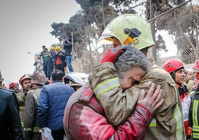 Firefighters react at the site of a collapsed high-rise building in Tehran, Iran January 19, 2017