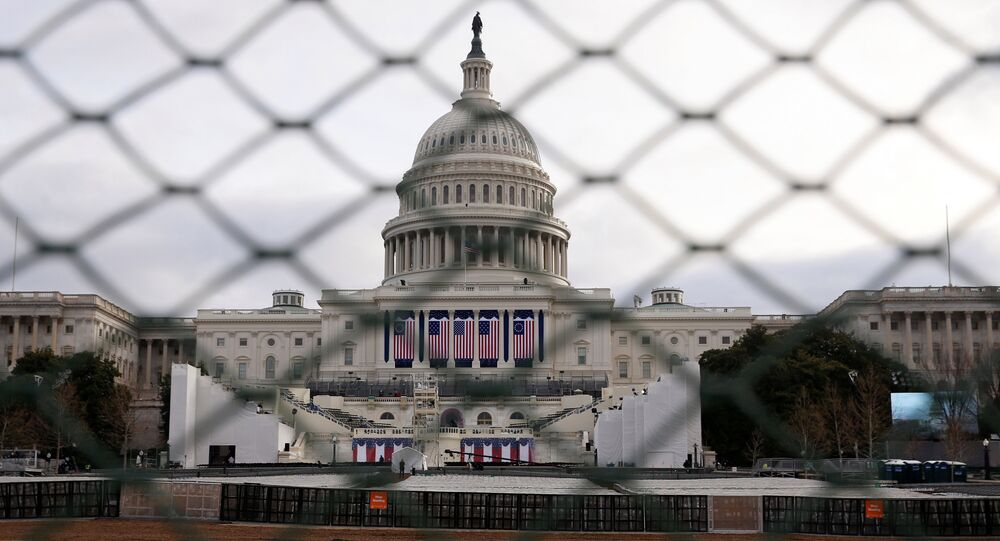 The U.S. Capitol building is seen behind a security fence in Washington, U.S., January 19, 2017