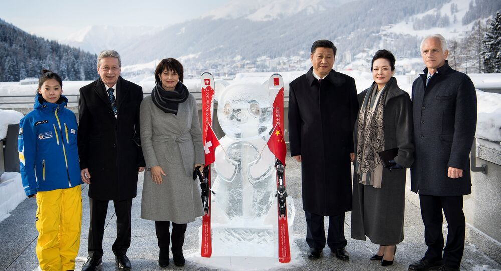 (L-R) Shuyao Song, Chinese skiing teacher in the ski resort of Davos, Doris Leuthard's husband Roland Hausin, Swiss Federal President Doris Leuthard, Chinese President Xi Jinping, Xi's wife Peng Liyuan, Tarzisius Caviezel, Mayor of Davos  stand near a panda ice sculpture as they launch the Swiss-Sino year of tourism on the side line of the 47th annual meeting of the World Economic Forum (WEF) in Davos, Switzerland, January 17, 2017