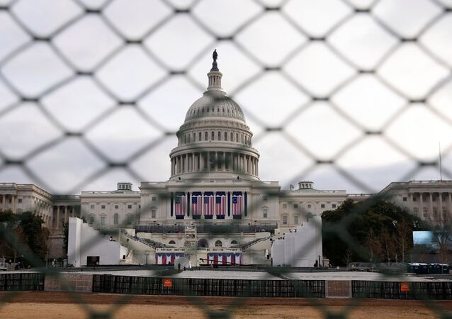 The U.S. Capitol building is seen behind a security fence in Washington ahead of the 2017 Presidential Inauguation.