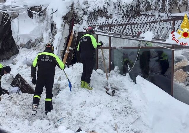 Firefighters work at Hotel Rigopiano in Farindola, central Italy, after it was hit by an avalanche, in this handout picture released on January 20, 2017 provided by Italy's Fire Fighters