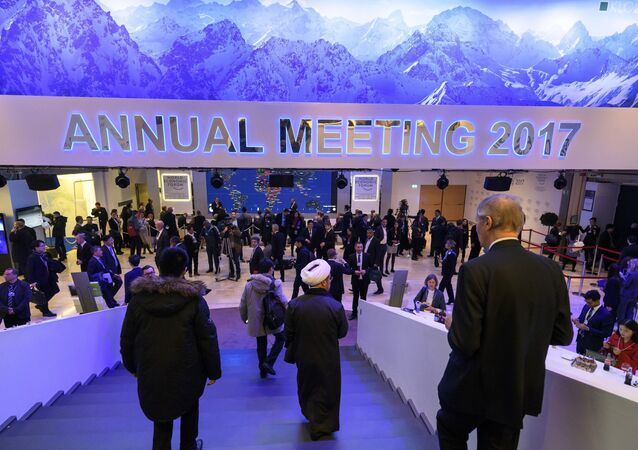 Participants to the World Economic Forum walk down the stairs in the Congress Centre, on the opening day of the World Economic Forum, on January 17, 2017 in Davos