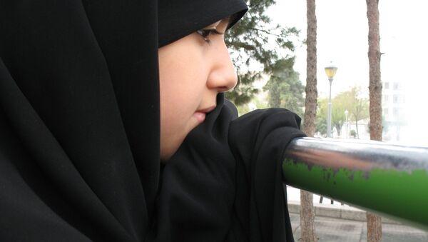 A veiled young woman - Sputnik International