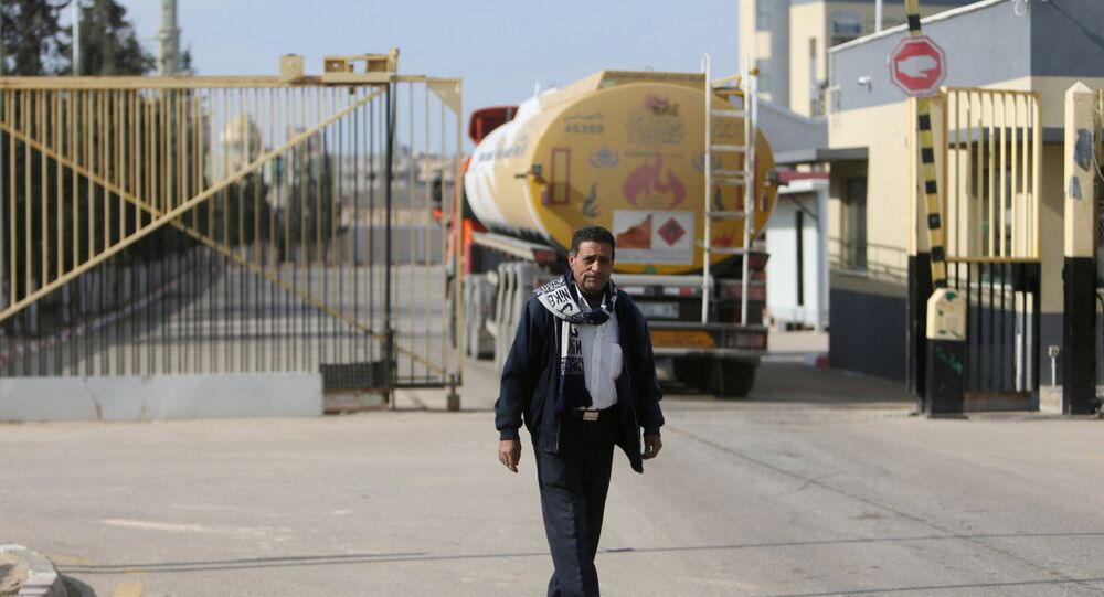 A man stands as a fuel tanker arrives at Gaza's power plant in the central Gaza Strip January 16, 2017