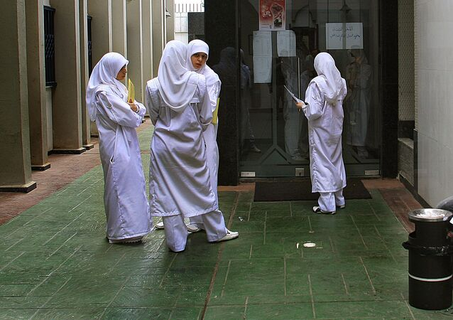 Young nurses wearing Islamic head-coverings stand at the entrance of the Medical Library at Rassoul al-Azaem Hospital, on the edge of the devastated southern suburbs of Beirut, 08 September 2006