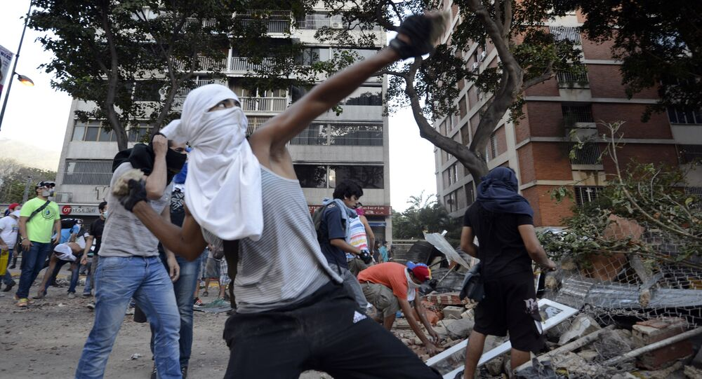 Opposition activists throw stones against National Guard members during a protest in Caracas (File)