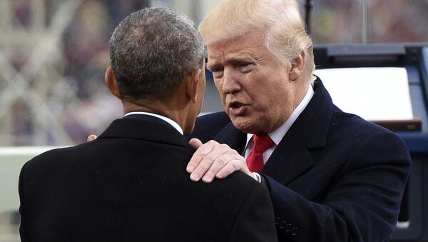 President Donald Trump talks with former President Barack Obama on Capitol Hill in Washington, Friday, Jan. 20, 2017, after Trump took the presidential oath - Sputnik International