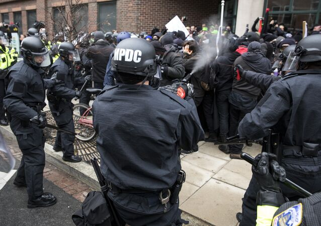 Police officers pepper spray a group of protestors before the inauguration of President-elect Donald Trump January 20, 2017 in Washington, DC.