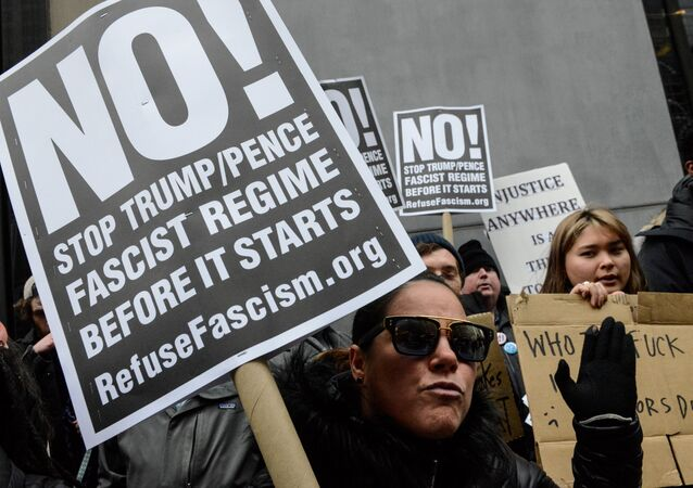A woman holds an anti-Trump sign during inauguration protests in New York City.