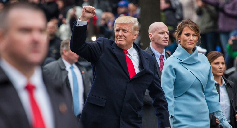 Donald Trump and his wife Melania take part in the inaugural parade in Washington. file photo