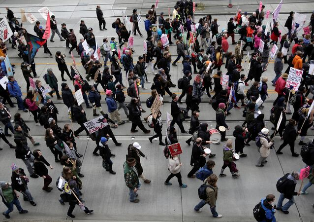 People march in protest to U.S. President Donald Trump's inauguration in Seattle, Washington, U.S. January 20, 2017
