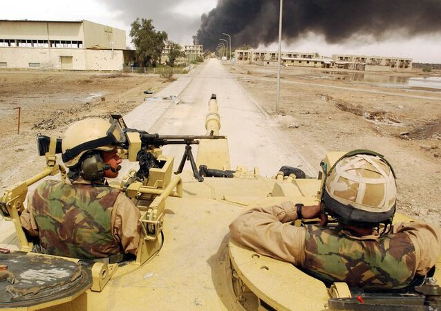 Alex Matheson, left, a member of the Desert Rats with his Challenger II tank man an operational post in Basra, southern Iraq, Friday April 4, 2003
