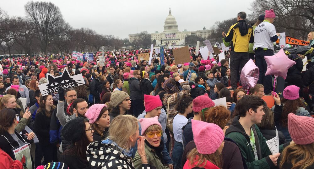 Demonstrators arrive on the National Mall in Washington, DC, for the Women's march on January 21, 2017