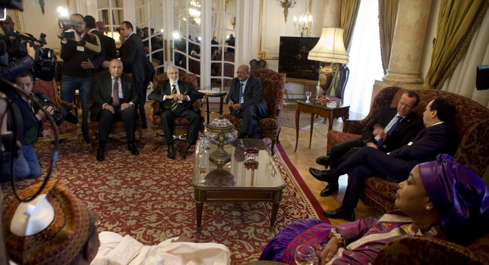 Libyan Foreign Minister, Mohamed Taher Siala, top center, attends a ministerial meeting of countries neighboring Libya which include Egypt, Tunisia, Algeria, Sudan, Niger and Chad, as well as United Nations envoy, Martin Kobler, third right, in Cairo, Egypt, Saturday, Jan. 21, 2017