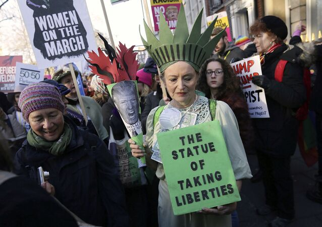 Demonstrators take part in the Women's March on London, following the Inauguration of U.S. President Donald Trump, in London, Saturday Jan. 21, 2016.