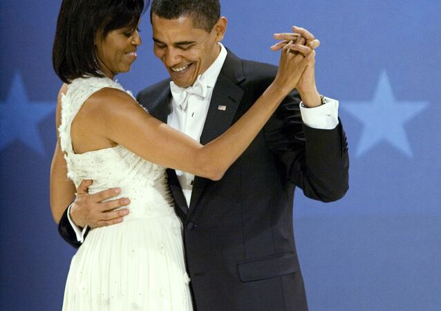 President Barack Obama dances with first lady Michelle Obama at the Midwestern Ball at Convention Center, Tuesday, Jan. 20, 2009, in Washington.