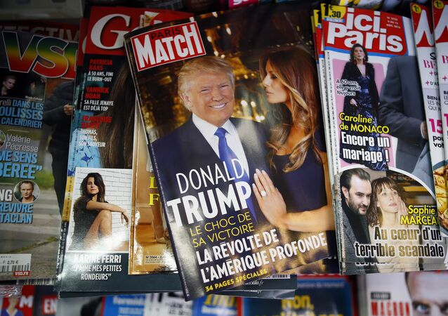 French newspapers with photos of U.S. President-elect Donald Trump are displayed on a newsstand, in Paris, France, Thursday, Nov. 10, 2016