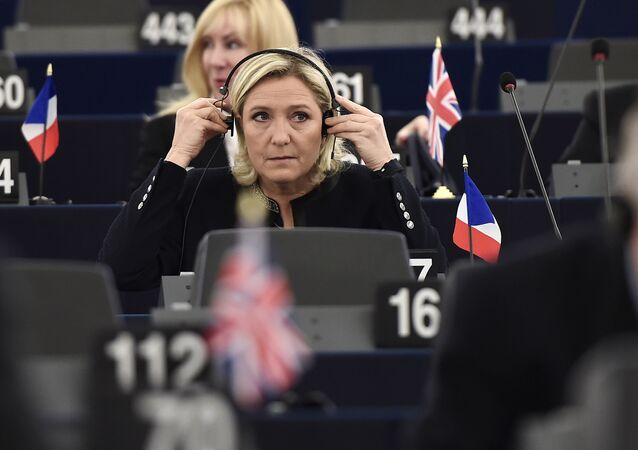 French Front National (National Front - FN) far-right party's President, European MP and candidate for the 2017 French Presidential elections Marine Le Pen adjusts her headphones as she attends a debate on the conclusions of the European Council meeting on October 20-21 at the European Parliament in Strasbourg, eastern France, on October 26, 2016