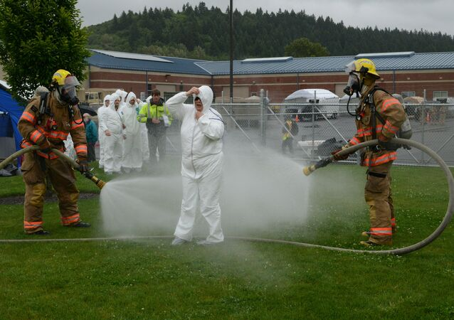 Firefighters decontaminate victims of a simulated bioterrorism attack at the Armed Forces Reserve Center during the Portland Area Capabilities Exercise (PACE) Setter at Camp Withycombe in Clackamas, Ore.