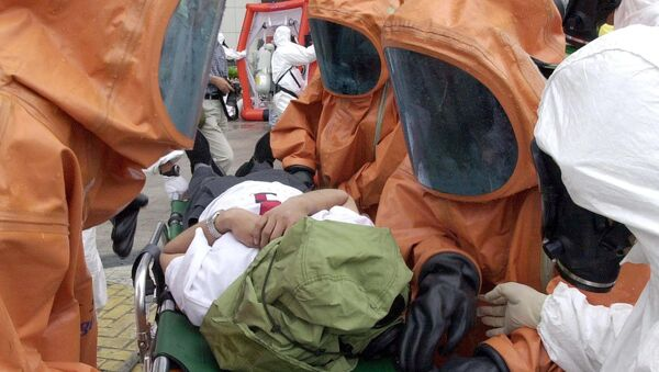 Anti-bioterror squad policemen carry a mock victim during an anti-chemical, biochemical and radiological terror exercise (File) - Sputnik International
