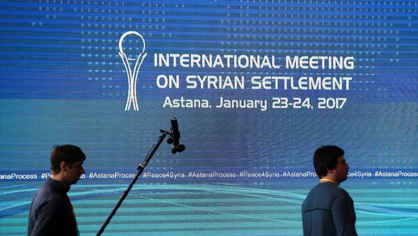 Reporters walk in the media center set for Syria peace talks, in Astana, Kazakhstan, January 23, 2017. - Sputnik International