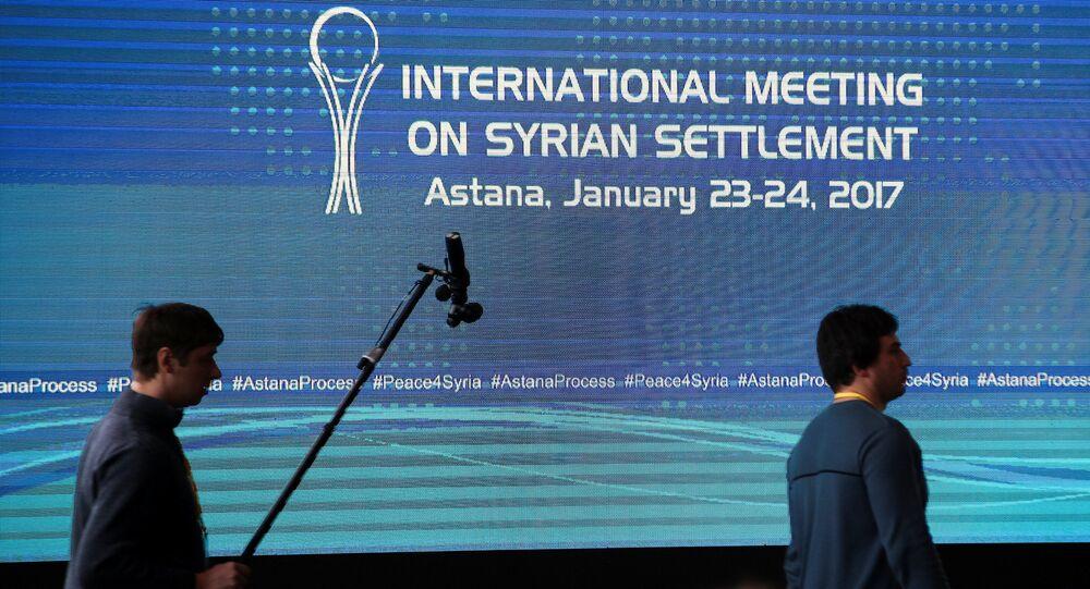 Reporters walk in the media center set for Syria peace talks, in Astana, Kazakhstan, January 23, 2017.
