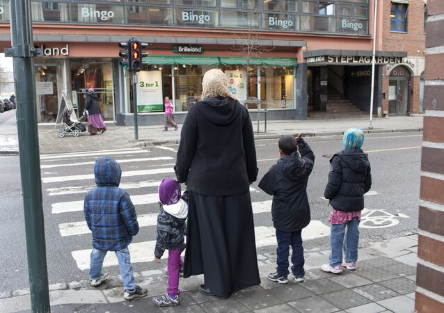 A norwegian muslim family is pictured at a crossroad in Oslo